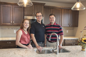 Werner Homes President Bob Werner, center, flanked by his son, Jake Werner, and daughter-in-law, Mandy Werner.